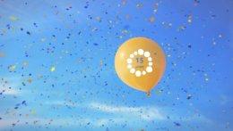 Ein gelber Luftballon fliegt in den Himmel und es regnet Konfetti